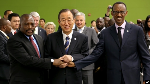 United Nations Secretary-General Ban Ki-moon, center, joins hands with President of the Democratic Republic of Congo Joseph Kabila Kabange, left, and President of Rwanda Paul Kagame at the 67th session of the U.N. General Assembly, Sept. 27, 2012.