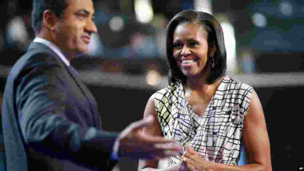 First Lady Michelle Obama on stage with actor Kal Penn for filming a campaign video inside Time Warner Cable Arena, Sept. 3, 2012.