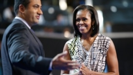 First Lady Michelle Obama on stage with actor Kal Penn at the Democratic National Convention inside Time Warner Cable Arena in Charlotte, N.C., on Monday, Sept. 3, 2012.