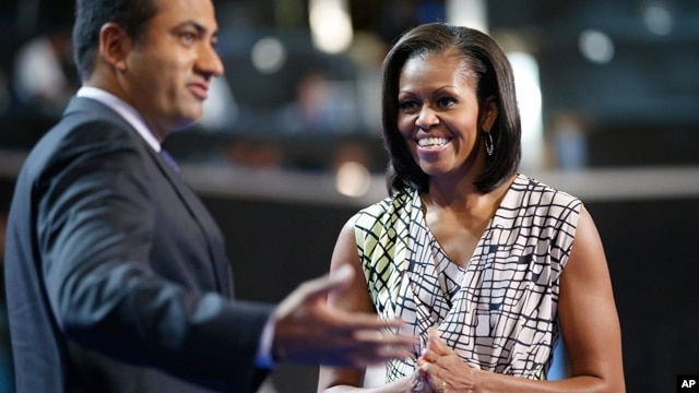 First Lady Michelle Obama on stage with actor Kal Penn for filming a campaign video at the Democratic National Convention inside Time Warner Cable Arena in Charlotte, N.C., on Monday, Sept. 3, 2012.