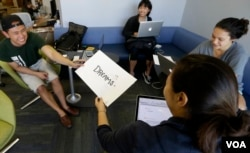 Students create pamphlets for Asian and Pacific Islands students about the Undocumented Student and AB540 Center at the University of California-Davis in 2015. (AP Photo/Rich Pedroncelli)