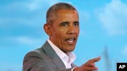 Former US President Barack Obama gestures to the crowd, during an event in Kogelo, Kisumu, Kenya, July 16, 2018.