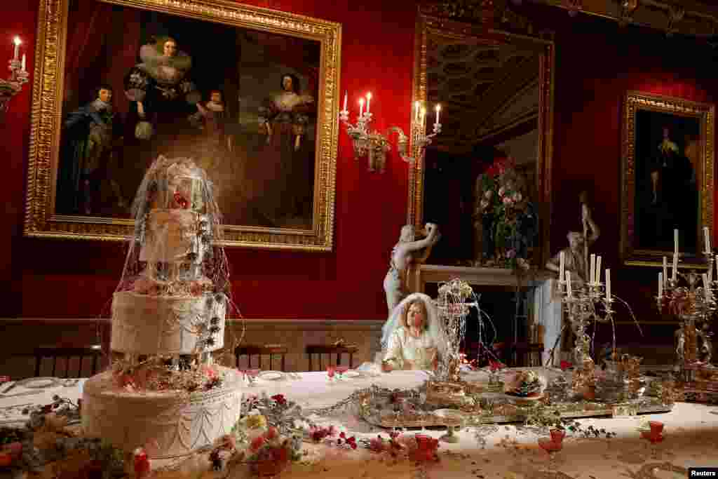 Carole Copeland poses as the character Miss Havisham during the Dickens themed annual Christmas event at Chatsworth House near Bakewell in Britain.