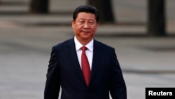 FILE - China's President Xi Jinping walks during a welcoming ceremony outside the Great Hall of the People in Beijing.