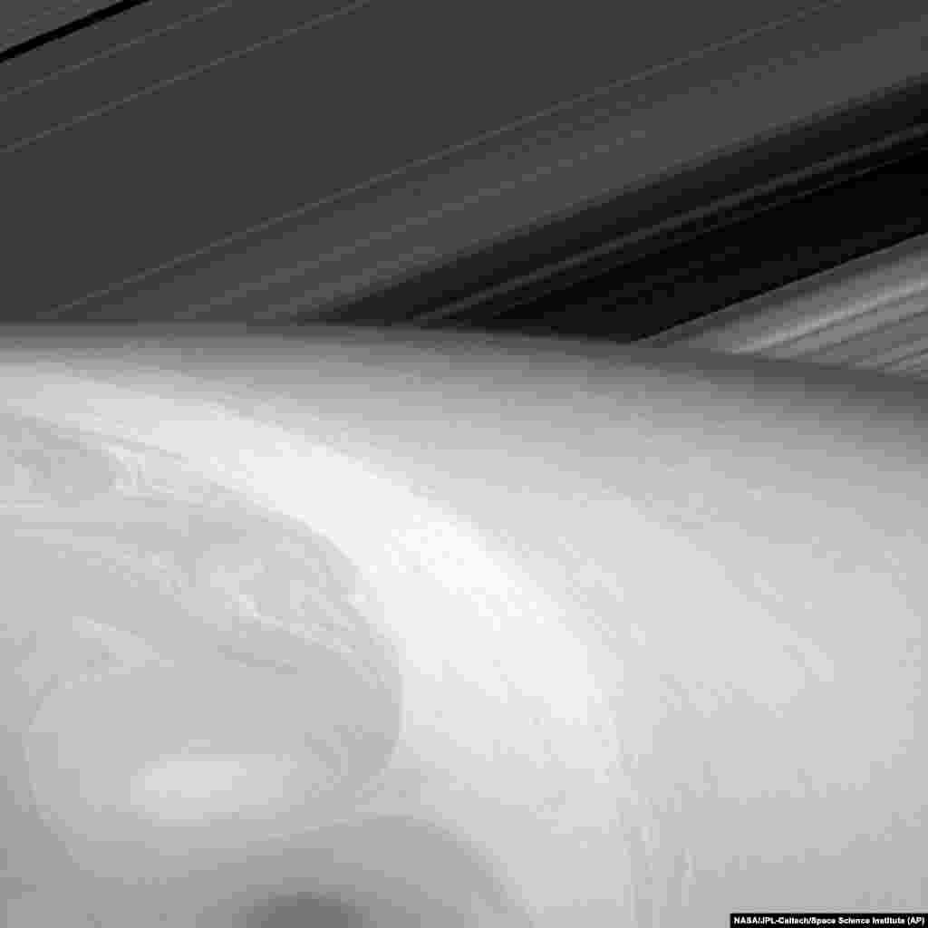This Aug. 23, 2014 image made available by NASA shows the fluid dynamics in Saturn's uppermost cloud layers.