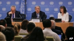 Secretary-General Antonio Guterres, center, accompanied by U.N. spokesman Stephane Dujarric, left, and Ninette Kelley, director of the office of the U.N. High Commissioner for Refugees, speaks to U.N. correspondents on World Refugee Day at U.N. headquarters in New York, June 20, 2017.