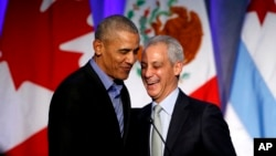 "Former U.S. President Barack Obama, left, laughs with Chicago Mayor Rahm Emanuel after Emanuel introduced Obama at a summit on climate change involving mayors from around the globe, Dec. 5, 2017, in Chicago. The City Council signed off May 23, 2018, on a proposal to build the Obama Presidential Center in a park on Chicago's South Side, a project that Emanuel said ""will tell a story about [how] America actually embraced its future, its diversity, its common sense of values."""