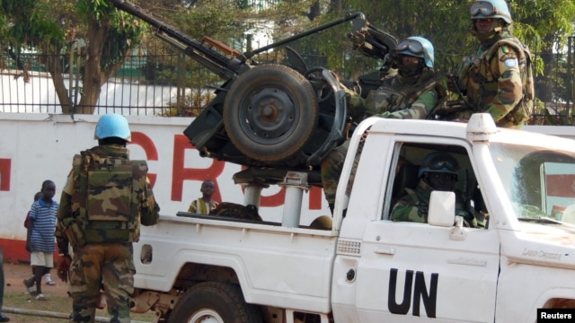 FILE - U.N. peacekeepers patrol a street in Bangui, the capital of Central African Republic, Dec. 30, 2015. A U.N. contingent was sent home in early 2016 from the Central African Republic following allegations of abuse.