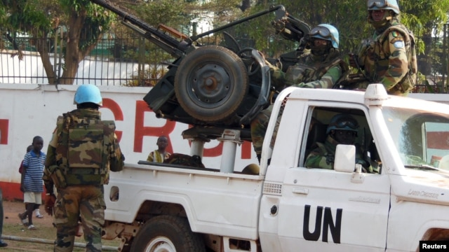 FILE - U.N. peacekeepers take a break as they patrol along a street during presidential elections in Bangui, the capital of the Central African Republic, Dec. 30, 2015.