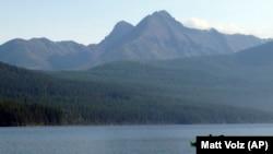 In this Sept. 6, 2013, file photo, Ingrid Forsmark kayaks on Kintla Lake in Glacier National Park, Mont.