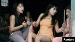 Here, ethnic Vietnamese sex workers wait for clients in a popular red light area in Phnom Penh, Cambodia. Red light areas are where people buy sex. (FILE PHOTO 2001)