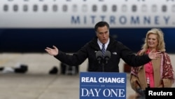U.S. Republican presidential nominee Mitt Romney and his wife Ann arrive at a campaign rally in Newington, New Hampshire, November 3, 2012.