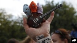 """Supporter of the punk band Pussy Riot with a sign on her wrist reading """"They are your children, Russia,"""" Moscow, Aug. 17, 2012."""