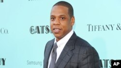 "FILE - Jay-Z attends ""The Great Gatsby"" world premiere at Avery Fisher Hall in New York, May 1, 2013."