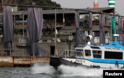 FILE - A Turkish coast guard boat patrols in front of the Reina nightclub by the Bosphorus, which was attacked by a gunman, in Istanbul, Jan. 1, 2017.