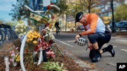 Eric Fleming, 41, stops by to express his condolences in front of a bike memorial where people leave flowers to remember the victims of an ISIS-inspired attack in New York.