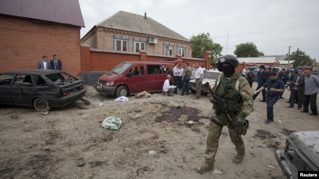 Investigators work at the site of a suicide bomb attack in the Malgobek district in the north of Ingushetia, August 19, 2012.
