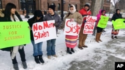 FILE - Demonstrators stand outside the Cass County Courthouse in Fargo, N.D., Dec. 6, 2017, during the trial of those accused of killing of 22-year-old Savanna Greywind of Fargo. The protesters were hoping to draw attention to unsolved killings of indigenous women.