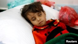 A girl infected with cholera rests at a hospital in Sanaa, Yemen, May 7, 2017.