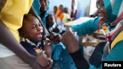 A child receives a meningitis vaccination at the community center in El Daein, East Darfur, Sudan on October 8, 2012.