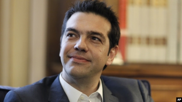 Greek leader of Coalition of the Radical Left party (SYRIZA) Alexis Tsipras looks on during a meeting with Greek President Karolos Papoulias, to formally take the mandate to form a coalition government in Athens.
