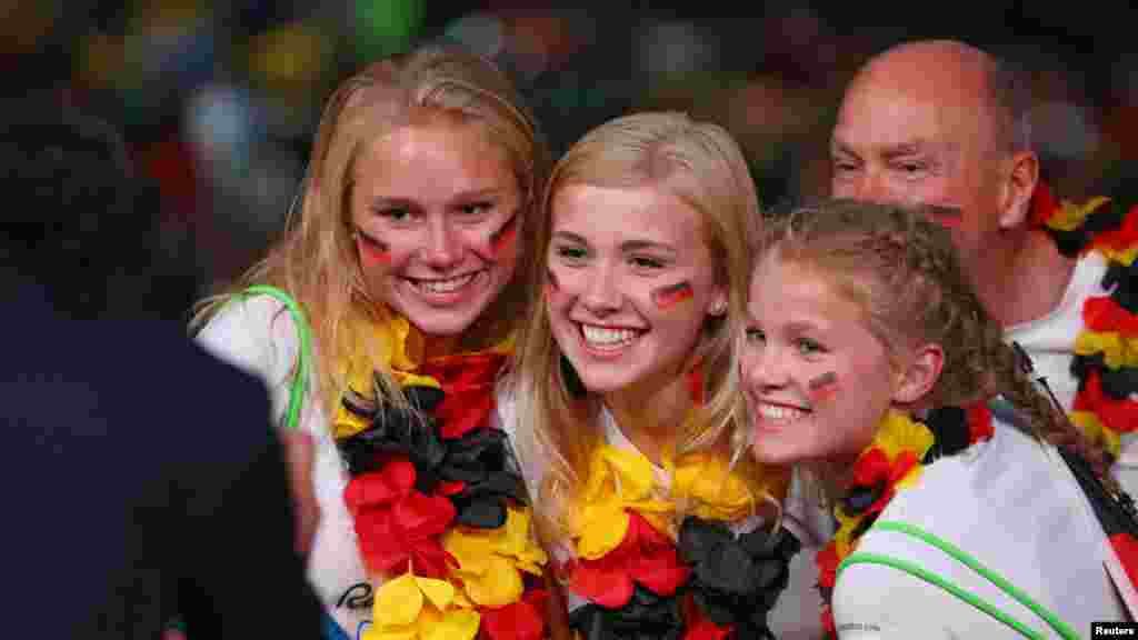 German fans have their photo taken before the opening ceremony. (Reuters/Mike Blake)