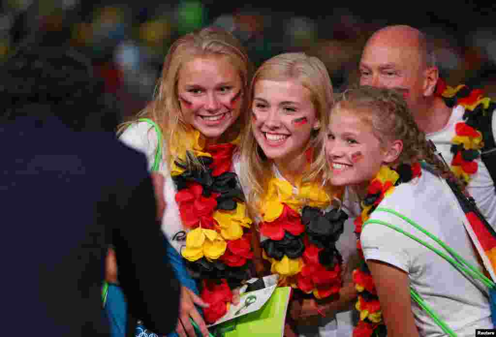 German fans have their photo taken before the opening ceremonies at the 2016 Summer Olympics in Rio de Janeiro, Brazil, Aug. 5, 2016.