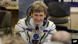 FILE - U.S. astronaut Peggy Whitson, member of the main crew of the expedition to the International Space Station, speaks with her relatives prior the launch of Soyuz MS-3 space ship at the Russian-leased Baikonur cosmodrome, Kazakhstan, Nov. 17, 2016.