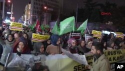 In this image from video, people march toward the Russian consulate in Istanbul to protest Russia's involvement in the Syrian government's push to retake rebel-held areas of the city of Aleppo, Dec. 13, 2016.