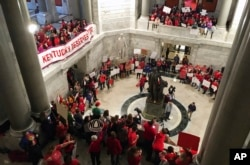 Hundreds of Kentucky teachers protest outside of Gov. Matt Bevin's office, March 30, 2018, in Frankfort, Ky. State lawmakers passed a bill late Thursday night that makes changes to the state's pension system.