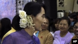 Burma democracy icon Aung San Suu Kyi talks to supporters before celebrations for the 96th birthday anniversary of her late father, General Aung San, and Myanmar Children Day at her National League for Democracy party's headquarters, in Rangoon, February