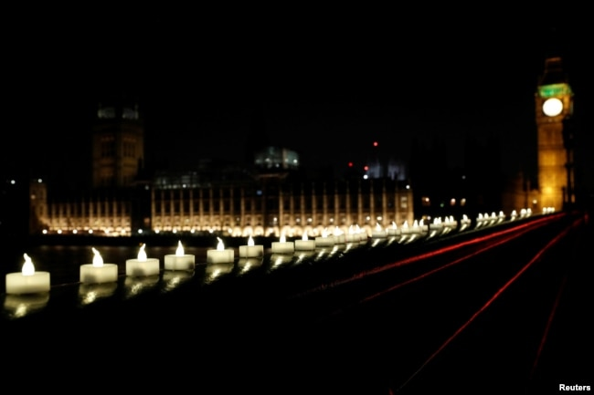 Candles burn on Westminster Bridge the day after an attack in London, March 23, 2017.