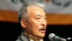 Former President of the Tibetan Association of Washington, Tashi N. Khamshitsang