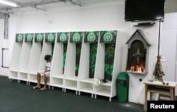 Leandro Bastos of Chapecoense's under-15 soccer team sits inside the team's locker room at the Arena Conda stadium in Chapeco, Brazil, Nov. 29, 2016.