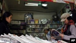 People browse through newspapers at a shop in Hanoi, Vietnam. (FILE)