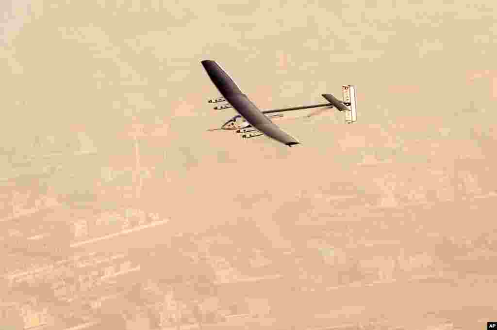 "In this photo released by Solar Impulse, ""Solar Impulse 2"", a solar-powered airplane flies after taking off from Al Bateen Executive Airport in Abu Dhabi, United Arab Emirates, marking the start of the first attempt to fly around the world without a drop of fuel."