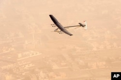 "FILE - In this photo released by Solar Impulse, ""Solar Impulse 2"", a solar-powered airplane flies after taking off from Al-Bateen Executive Airport in Abu Dhabi, United Arab Emirates, March 9, 2015."
