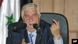 Syrian Foreign Minister Walid Moallem speaks during a news conference in Damascus, June 22, 2011