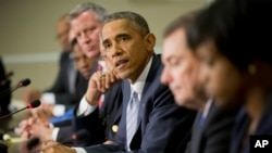 Presiden Obama dalam pertemuan dengan kabinetnya, para pemimpin HAM dan penegak hukum di Gedung Putih, Senin (1/12).