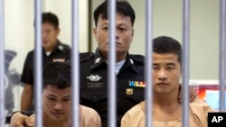 Myanmar migrants Win Zaw Htun, right, and Zaw Lin, left, both 22, are escorted by officials after their guilty verdict at court in Koh Samui, Thailand, Thursday, Dec. 24, 2015.