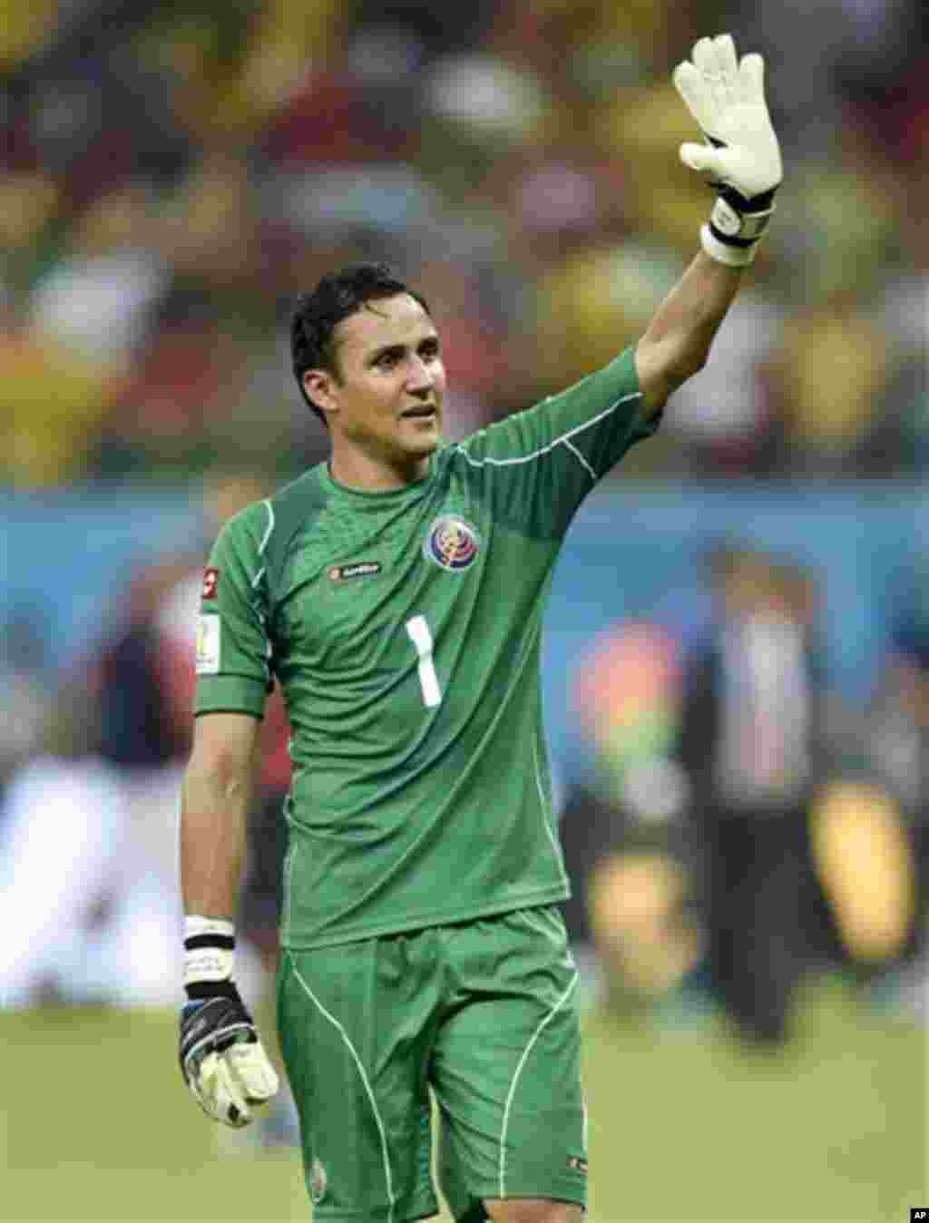 Costa Rica's goalkeeper Keylor Navas waves to supporters after Costa Rica defeated Greece 5-3 in penalty shootouts after a 1-1 tie during the World Cup round of 16 soccer match between Costa Rica and Greece at the Arena Pernambuco in Recife, Brazil, Sunda
