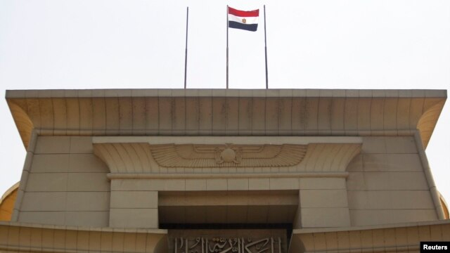 The Egyptian flag is seen atop the Supreme Constitutional Court building in Cairo in this July 4, 2013, file photo.