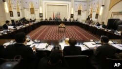 FILE - Delegations from Afghanistan, Pakistan, the United States and China discuss a road map for ending the war with the Taliban at the Presidential Palace in Kabul, Afghanistan, Feb. 23, 2016.