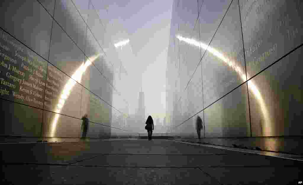 "A visitor walks through the ""Empty Sky"" memorial to New Jersey's victims of the Sept. 11, 2001 terrorist attacks in Jersey City, New Jersey, USA."