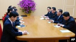 In this photo provided by South Korea Presidential Blue House via Yonhap News Agency, Kim Yong Chol, vice chairman of North Korea's ruling Workers' Party Central Committee, second from right, talks with South Korean delegation in Pyongyang, North Korea.