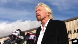 Virgin Galactic founder Richard Branson, speaking to reporters in Mojave, Calif., salutes the bravery of pilots who were testing his spacecraft, Nov. 1, 2014.