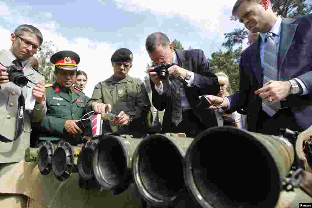 Foreign military attaches and media look at grenade launchers seized from pro-Russian separatists in the eastern regions of Ukraine, Aug. 29, 2014.
