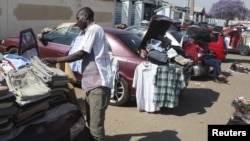 Hawkers sell goods on the streets of Zimbabwe's capital Harare.