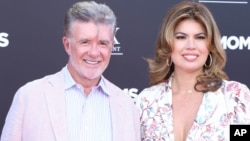 "Alan Thicke and wife Tanya Callau at the premiere of ""Bad Moms."" Thicke died of a heart attack Dec. 13, 2016."