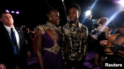 """Cast members Chadwick Boseman and Lupita Nyong'o attend the premiere of """"Black Panther"""" in Los Angeles, Jan. 29, 2018."""